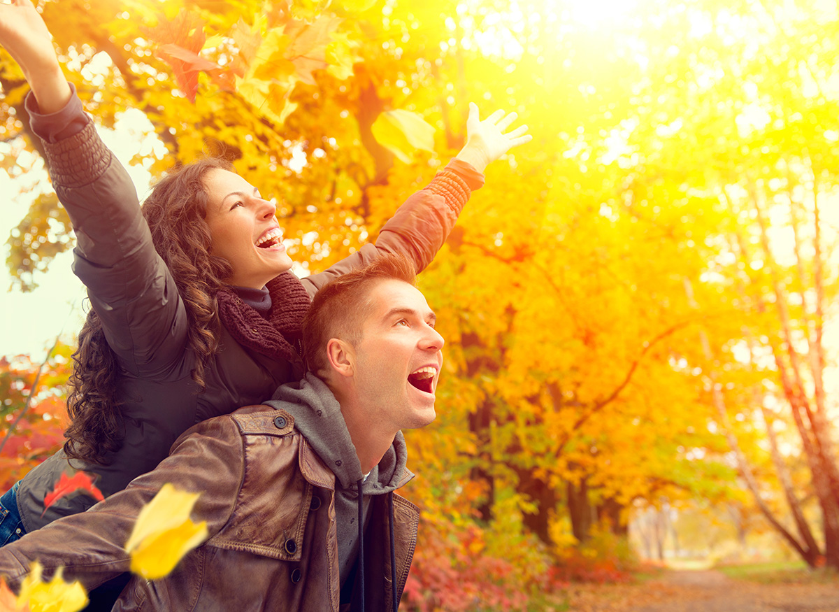 couple happy in fall leaves